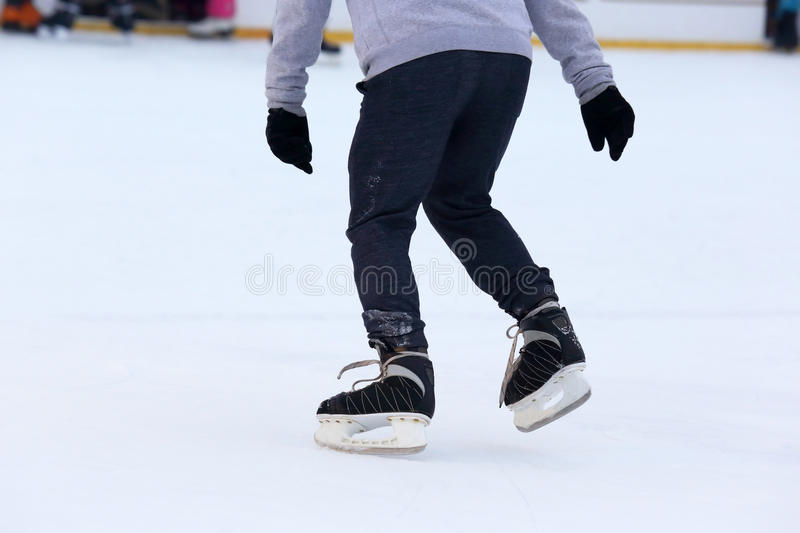 Man skating on an ice rink. The man skating on an ice rink stock photo
