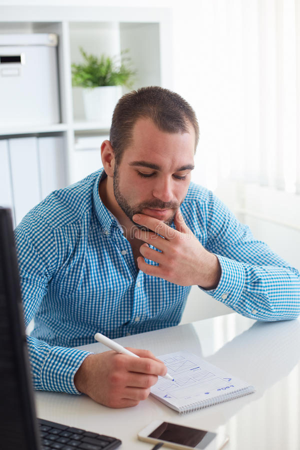 Man sketching web design stock photography