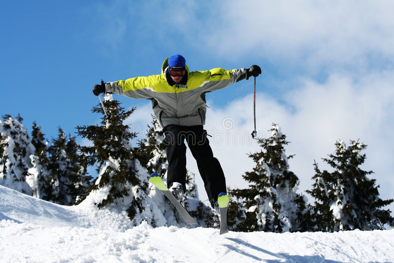 Man ski jump stock photo