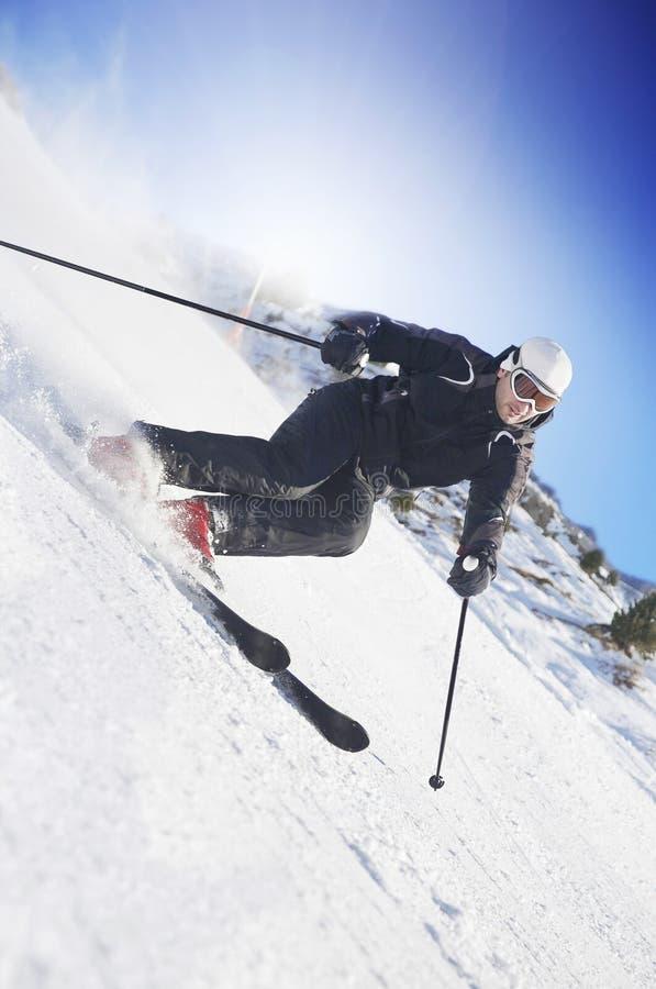 Free Man Skiing On Swiss Slopes Stock Photos - 22430503