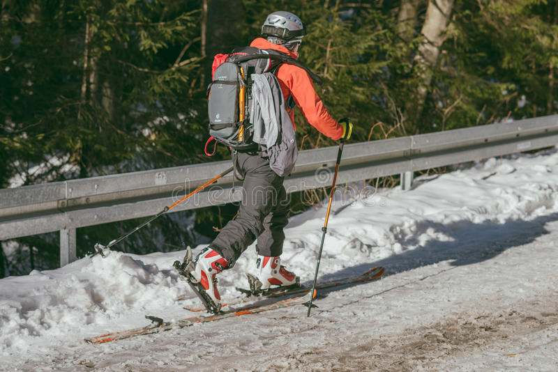 Man skiing on road to Morskie Oko lake stock photography