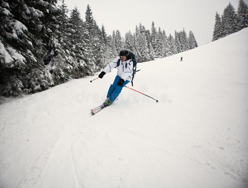 Man skiing on slope stock photography