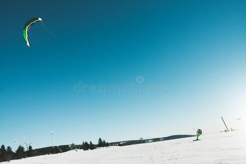 Man Skiing on Snow Covered Landscape stock photos