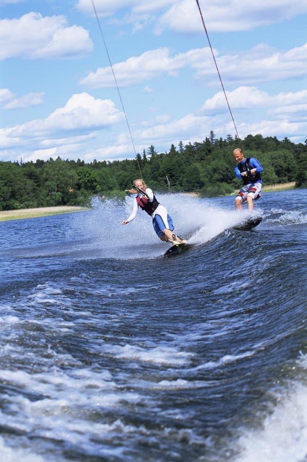 man skiing water woman στοκ εικόνες