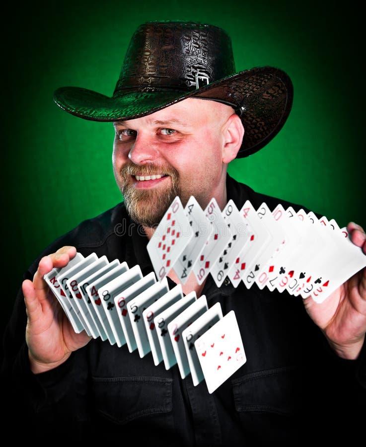 Man skilfully shuffles playing cards.  royalty free stock image