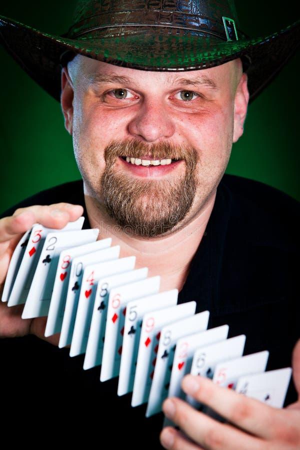 Man skilfully shuffles playing cards.  stock photography