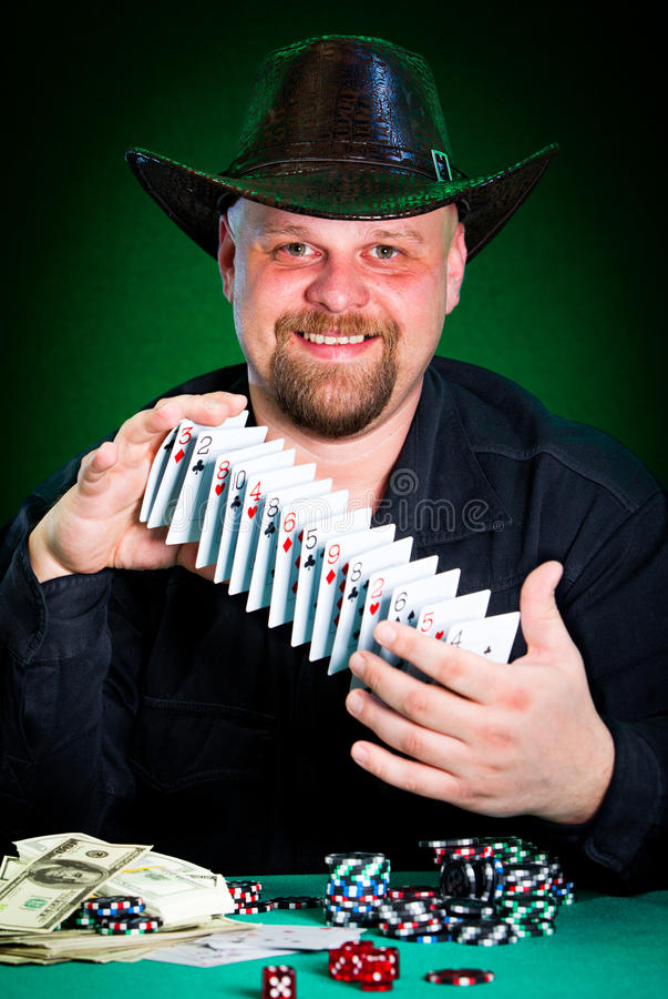 Man skilfully shuffles playing cards.  royalty free stock photos