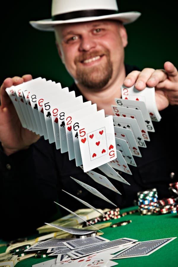 Man skilfully shuffles playing cards.  royalty free stock photography