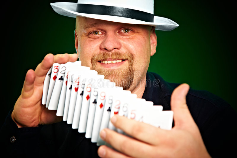Man skilfully shuffles playing cards.  stock images