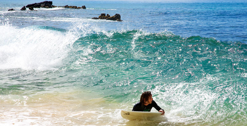 A man skimboarding at Big Beach in Maui stock photos