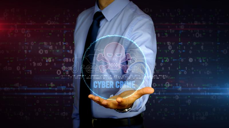 Businessman with skull hologram. Man with skull symbol hologram on hand. Businessman showing futuristic concept of cyber attack, online crime, pirate, theft and royalty free stock photography