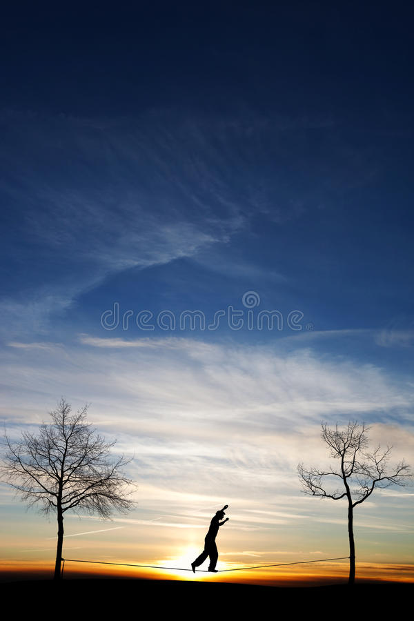 Man on slackline. In sunset sky royalty free stock photo
