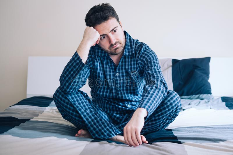 Man with sleep problem in his bed at home royalty free stock image
