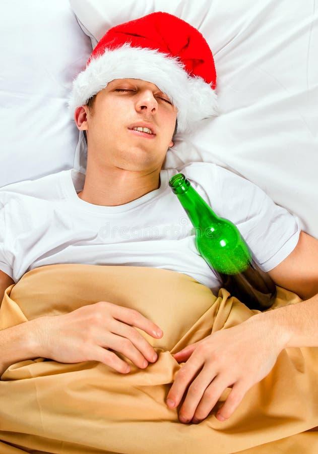 Man sleep in Santa Hat stock photos