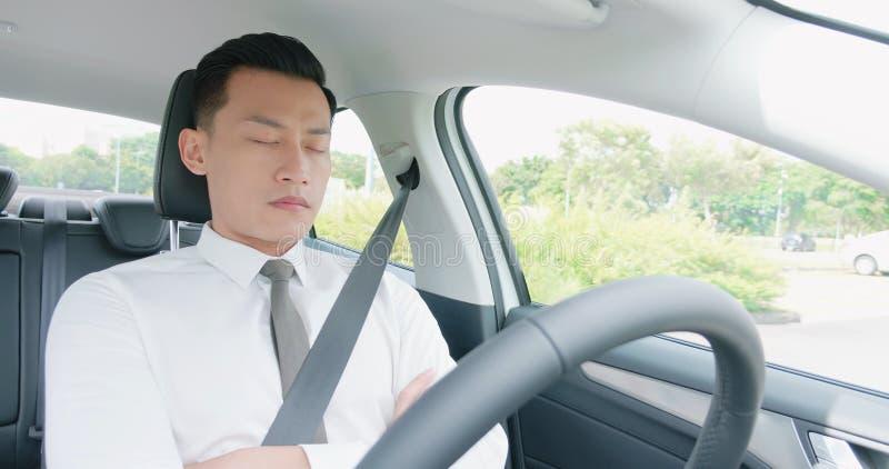 Man sleep in smart car stock image