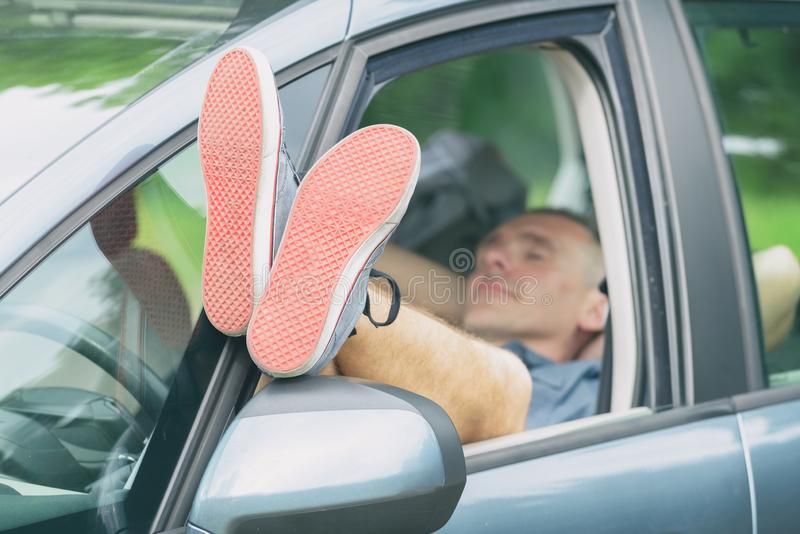 Man sleeping in the car stock photo