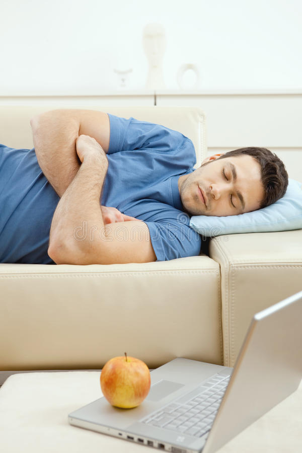 Download Man sleeping on couch stock photo. Image of beige, good - 9524924