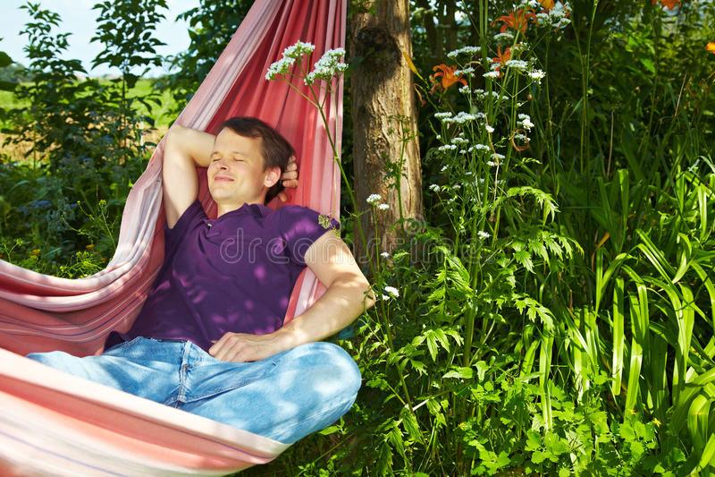 Download Man sleeping in hammock stock image. Image of outside - 14980657