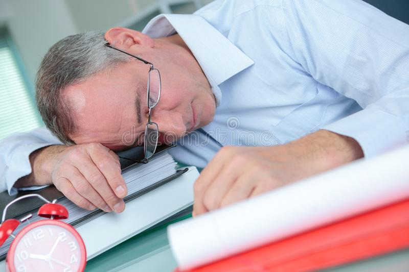 Man sleeping in office royalty free stock image