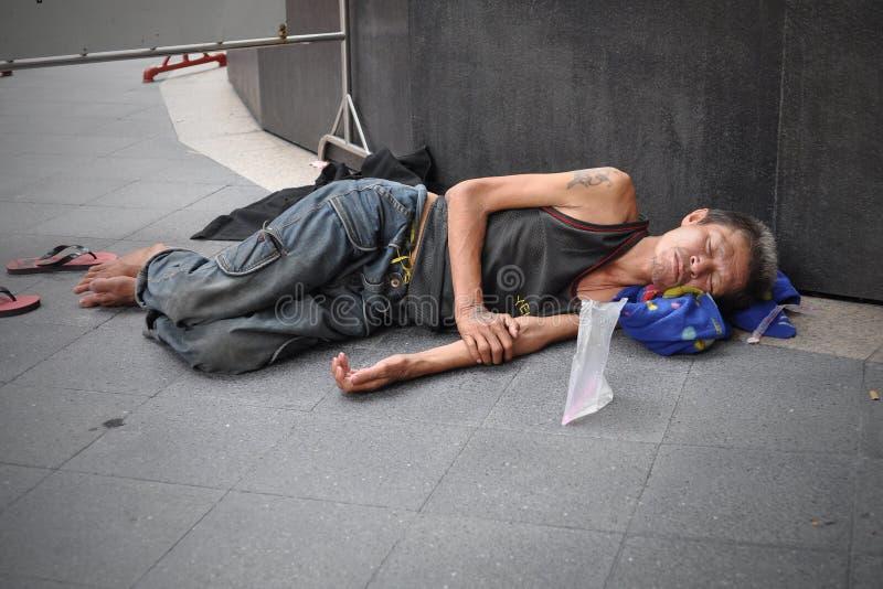 Man Sleeps on the Street in Bangkok stock photos