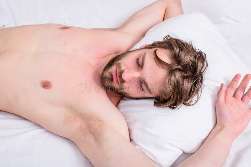 Man sleepy drowsy bearded face having rest. Pleasant awakening concept. Guy sleepy morning nap. Man unshaven handsome stock images