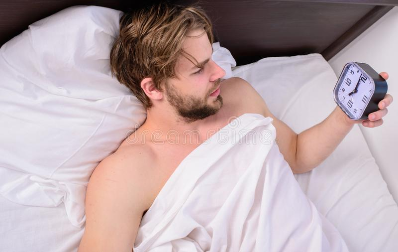 Man sleepy drowsy unshaven bearded face covered with blanket having rest. Stick sleep schedule same bedtime and wake up royalty free stock photography