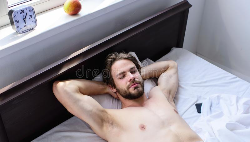 Man sleepy drowsy unshaven bearded face having rest. Pleasant relax concept. Let your body feel comfortable. Man royalty free stock image