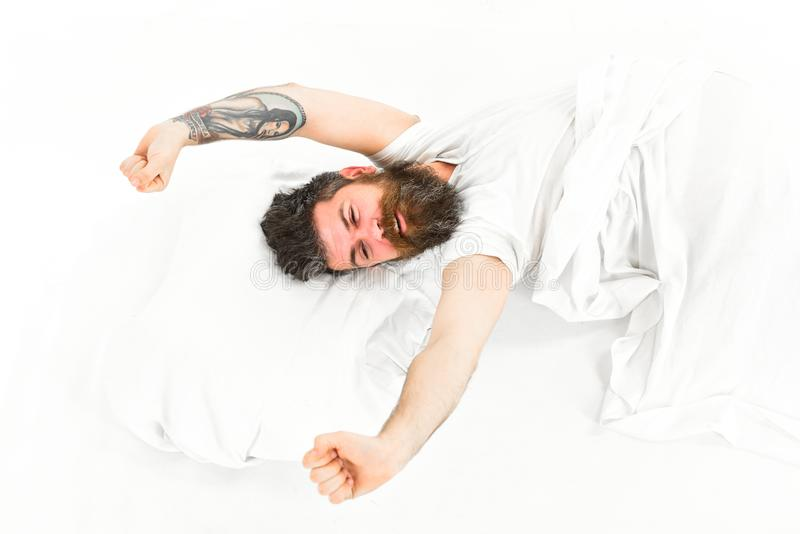 Man slept well, white background. Good morning concept. Man with sleepy face stretching, wake up. Hipster with beard stretching arms, energetic and successful stock photography