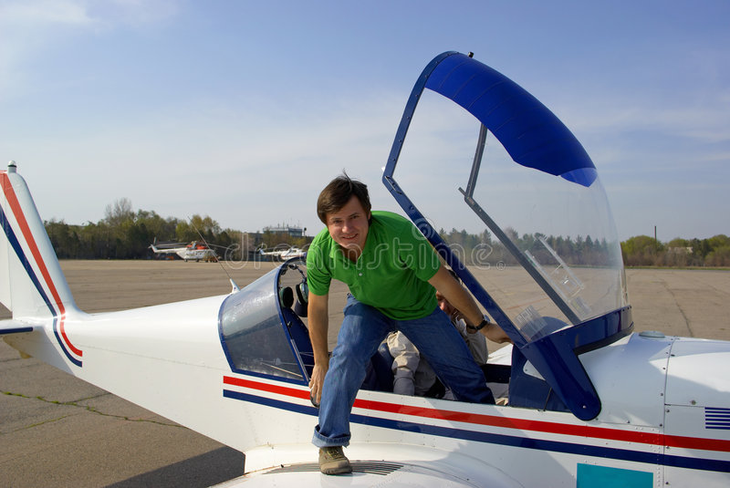 Man in small airplane royalty free stock image