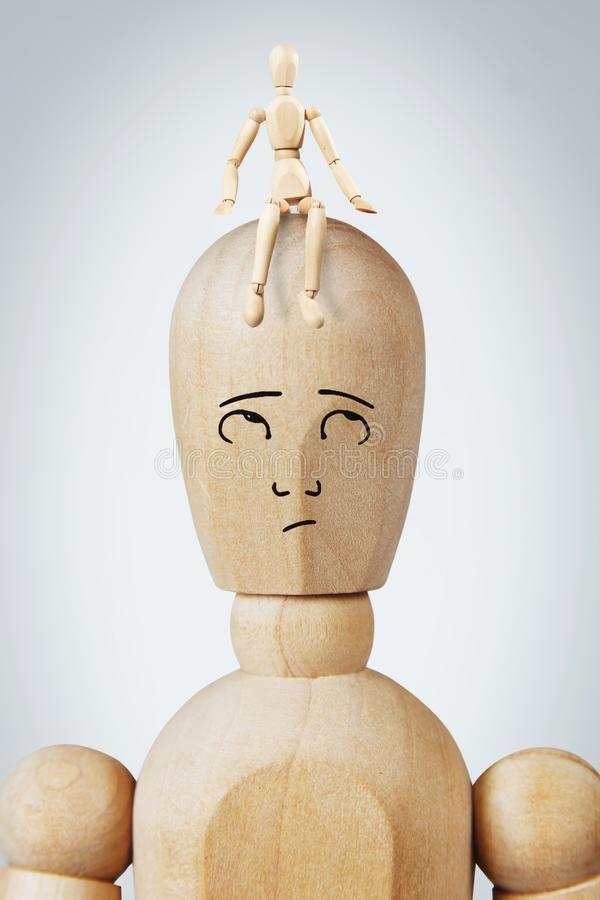 Man with a small another man sitting on his head royalty free stock image
