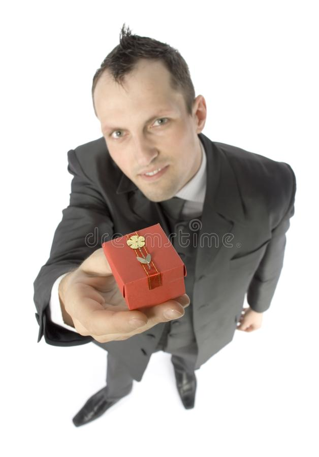 Man with small gift stock photography