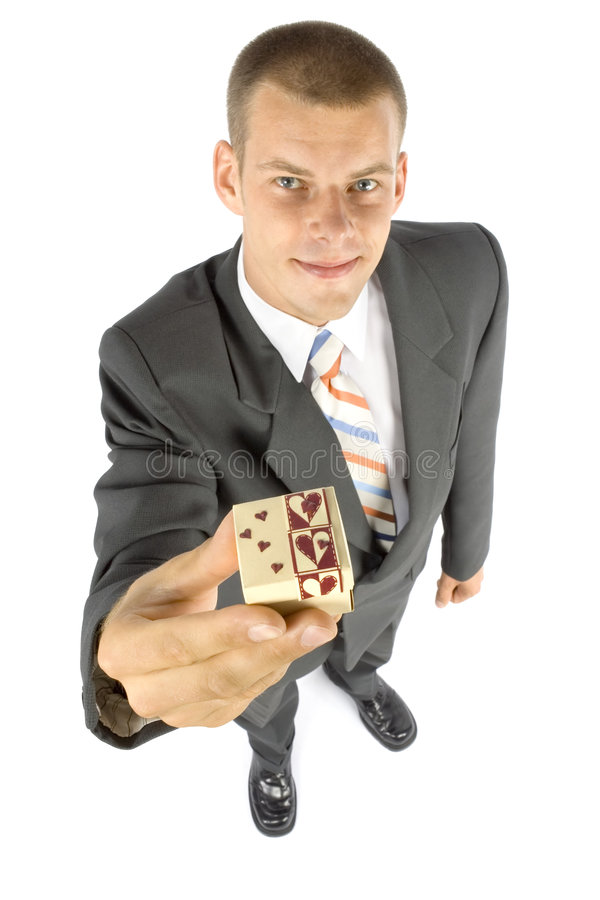 Man with small gift. Isolated man with small gift (focus on gift stock photo