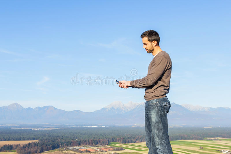 Man and smartphone stock images