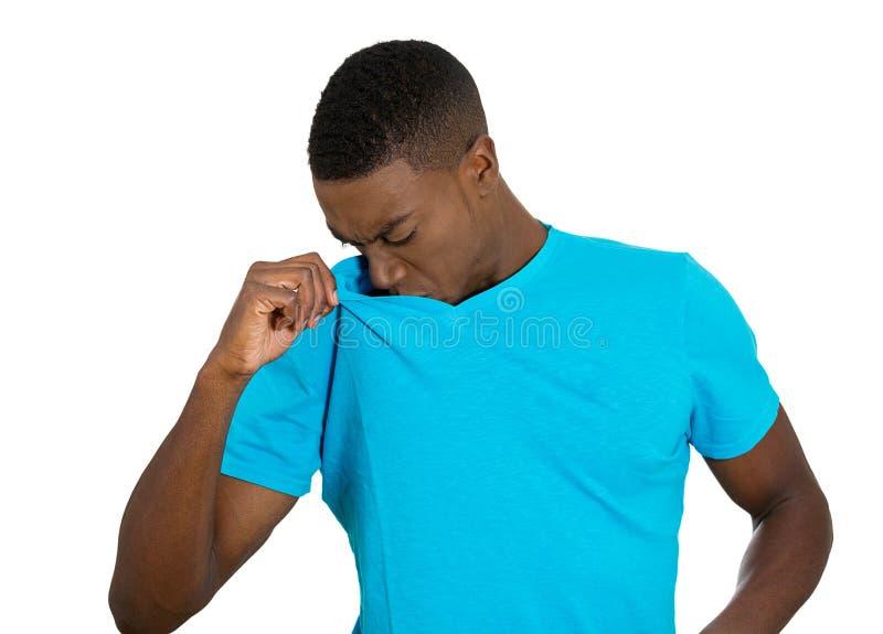 Man, Smelling sniffing Armpit, sweating something Stinks stock images