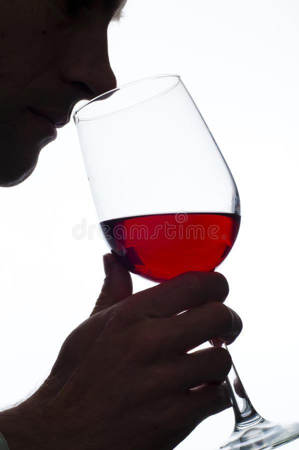 Man smelling wine. Man smelling red wine on white backgound royalty free stock images