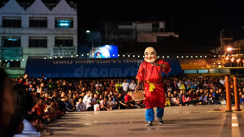 Man with smile face mask. KORAT, THAILAND - JANUARY 28, 2017: Unidentified man with smile face mask to perform Lion dance stock photography