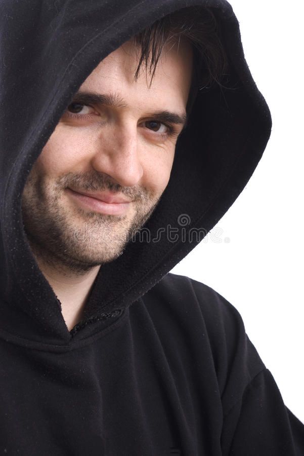 Man smiling in black sweatshirt with hood on white stock image