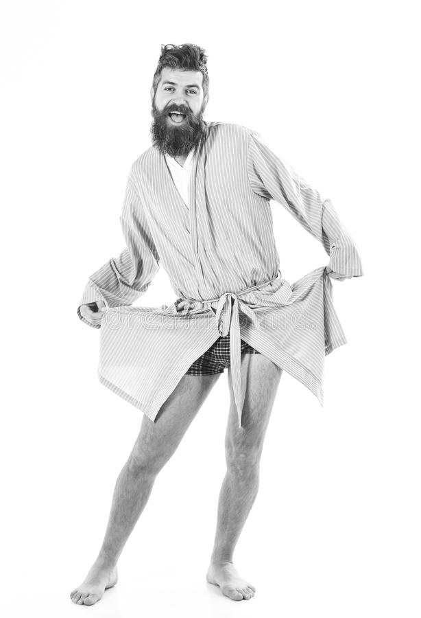Man with smiling face in good mood on white background. Slept well concept. Guy stand in bathrobe, dancing or posing in. Morning, copy space. Hipster with beard royalty free stock photos