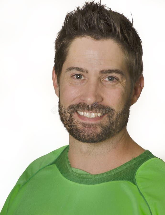 Man smiling wearing green soccer football shirt stock photos