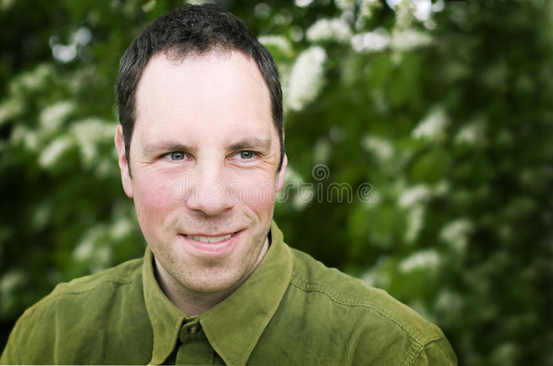 Man smilling portrait. Outdoors nature stock images