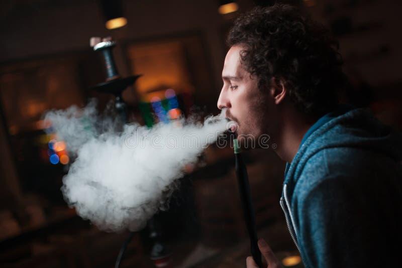 Man smokes hookah royalty free stock photos