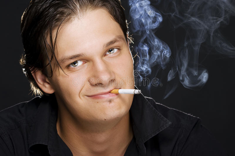Download Man smoking a cigarette stock image. Image of lifestyle - 15256443