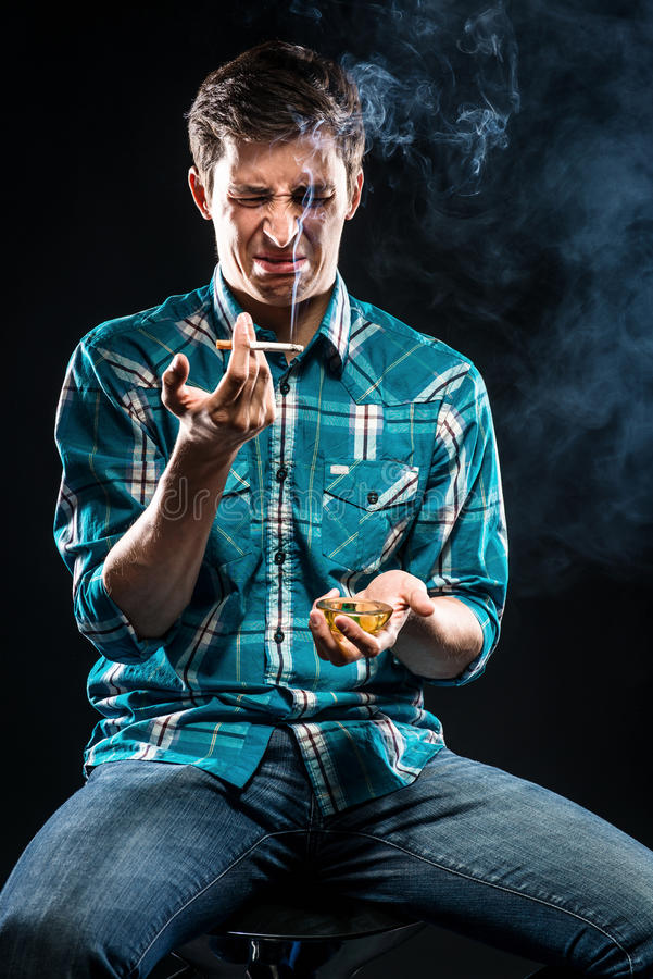 Download Man smoking cigarette stock image. Image of casual, expression - 33245127