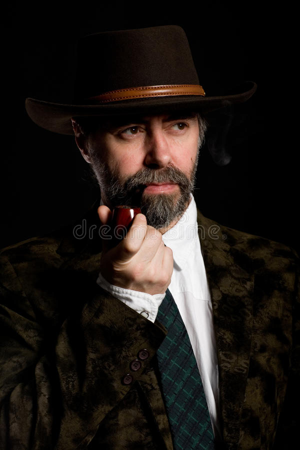 Download Man with a smoking pipe. stock photo. Image of mature - 17622688