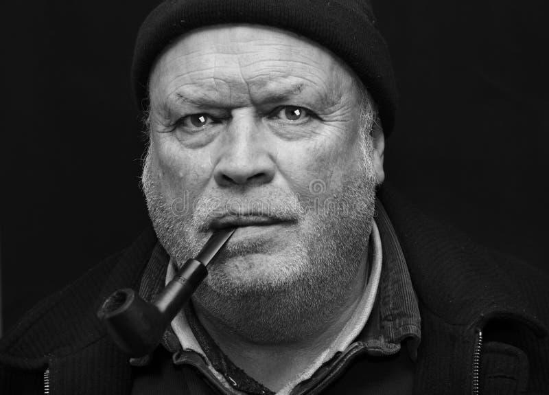 Download Man smoking pipe stock photo. Image of stubble, portrait - 18010218