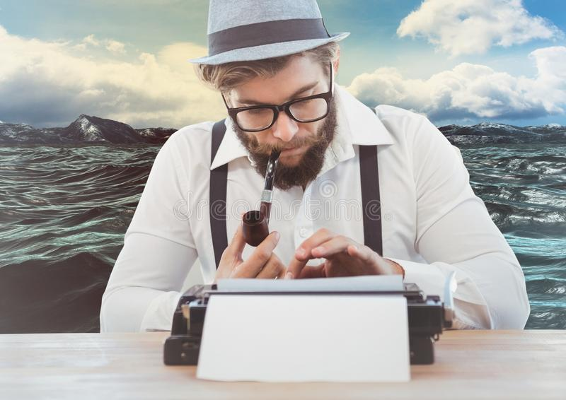 Man with smoking pipe using vintage type writer against sea background. Digital composite image of man with smoking pipe using vintage type writer against sea stock image