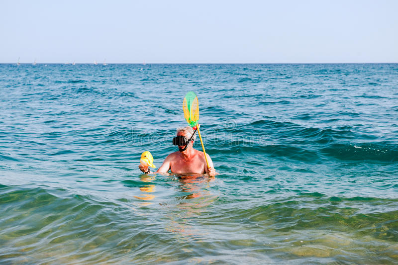 Download Man is snorkeling stock photo. Image of coast, elderly - 17642616