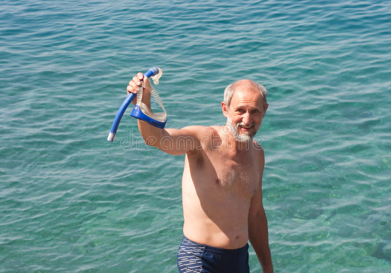 Download Man Snorkeling In The Background Sea Stock Photo - Image: 14328152