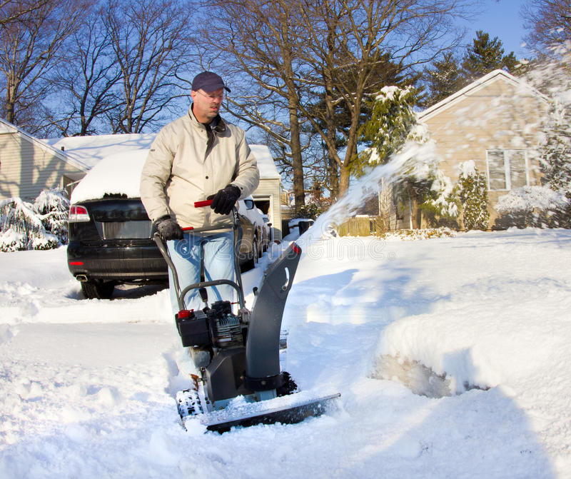 Man with Snow Blower stock image