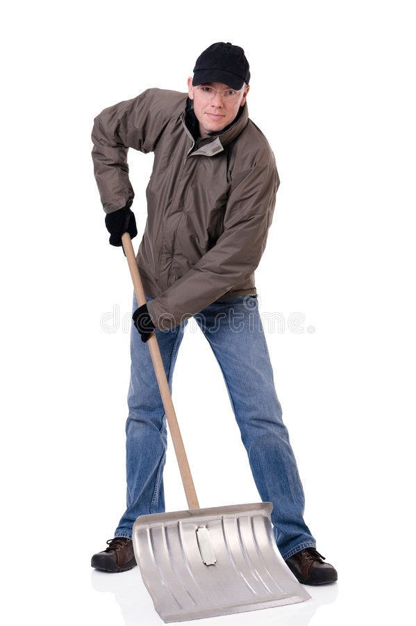 Man with snow shovel. Full isolated studio picture from a young man with a snow shovel stock image